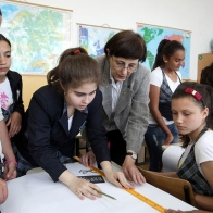 May 8, 2013 - Romania. History teacher (center) helps her students during class exercise at the Scoala Frumusani School in the village of Frumusani
